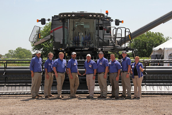 Group photo with tractor at training expo