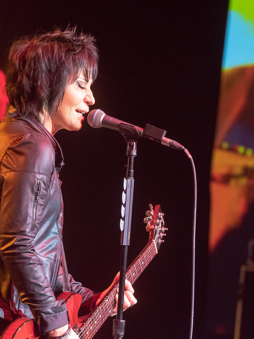 Joan Jett singing at corporate function