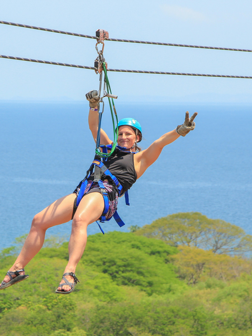 Woman ziplining in Costa Rica