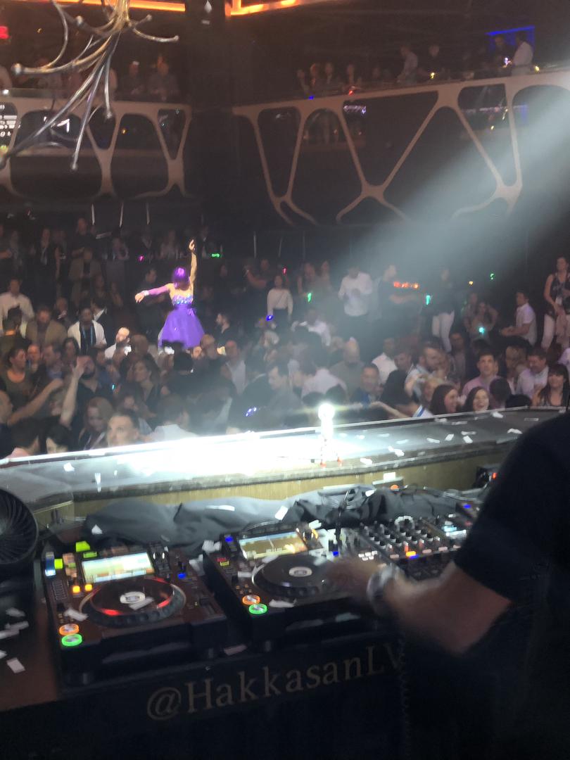 DJ and dancers at Las Vegas customer appreciation event