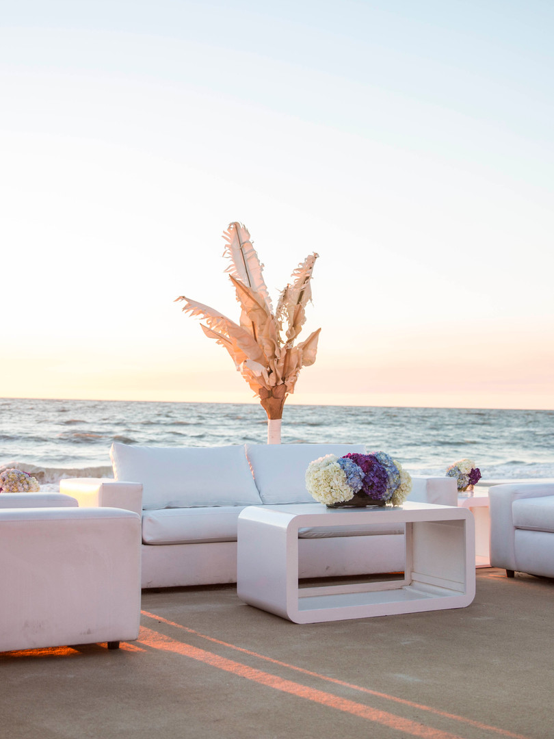 Beach seating created with couches for welcome reception