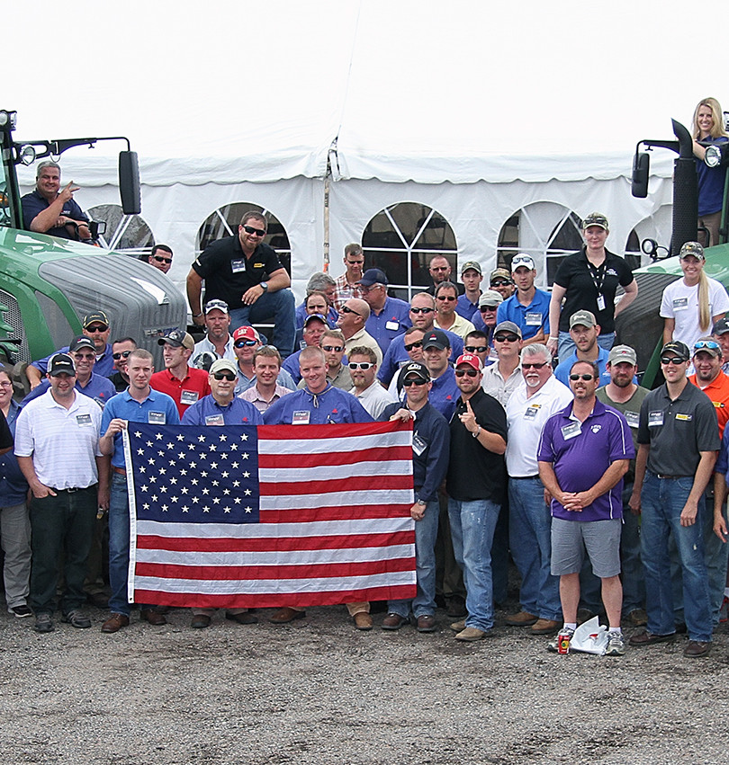 AGCO Training event attendees hold the American flag