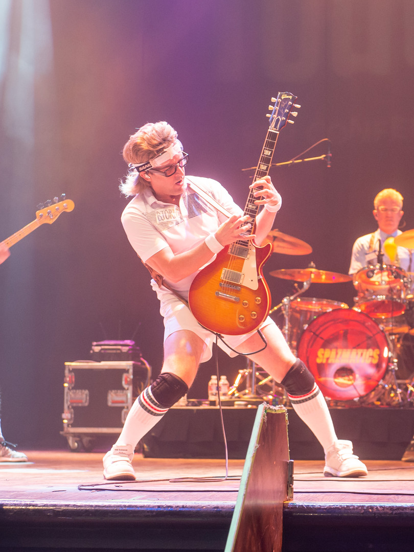 Spazmatics band performing on stage
