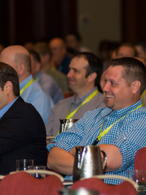 Attendees at a user conference general session
