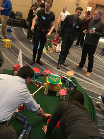 Group building a golf course with canned items