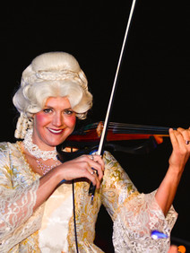 Costumed violin player for themed entertainment