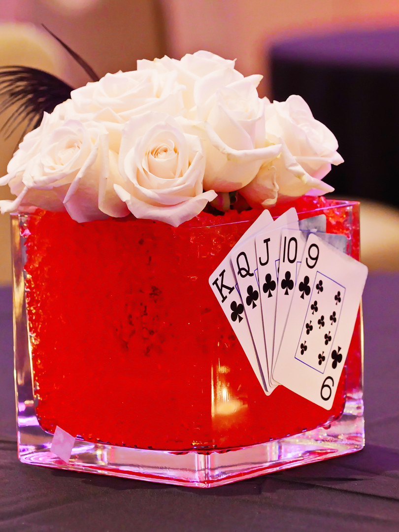 Casino themed centerpieces incorporated