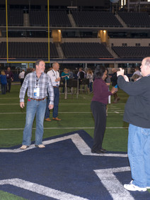 People taking pictures on Dallas Cowboys field