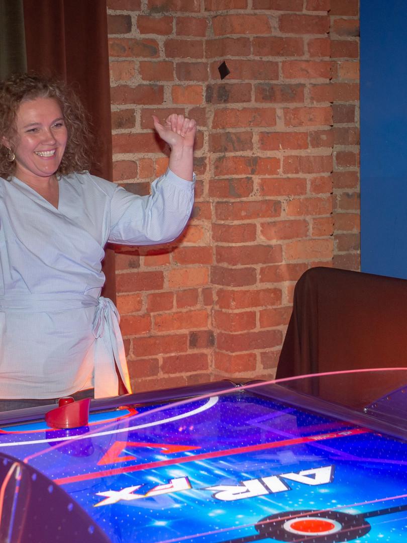 Woman playing air hockey
