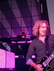 Lead guitarist of Foreigner performing at corporate event