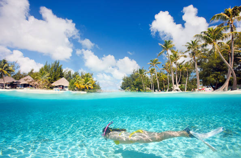 Woman snorkeling during business trip down time