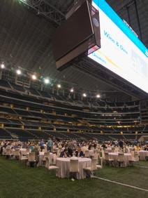Attendees dining on football field