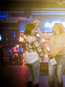 Women dancing at FGL House