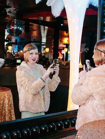 Flapper girl taking selfie at Roaring at Rising corporate event