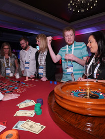 Attendees playing roulette at Aptean Use