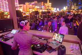 Female DJ performing on Omnia Rooftop for customer appreciation party after Omnitracs User Conference