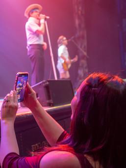 Woman recording event entertainment