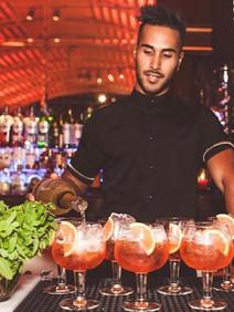 Mixologists creating bespoke cocktails