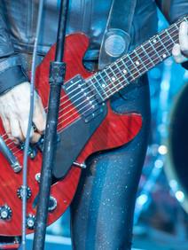 Joan Jett holding red guitar