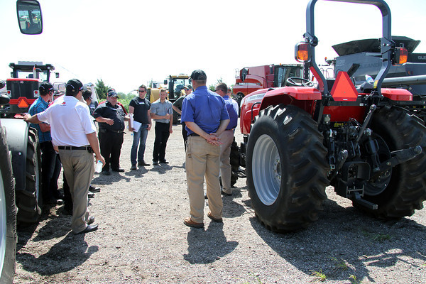Breakout session held outdoors for large equipment training