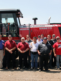 Group photo in front of tractor after training complete