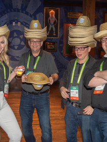 Group having fun with cowboy hats