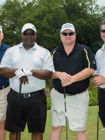 Group photo of team at golf tournament