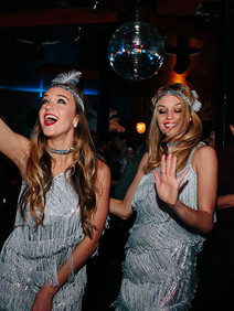 Flapper girls at 1920s corporate event