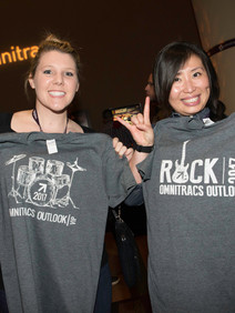 Women holding up their custom shirts