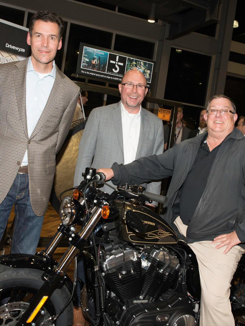 Winner of Harley Davidson giveaway at customer apprecation party
