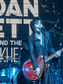 Joan Jett performing at conference