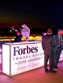 Branded lighted bar created for welcome reception on the beach
