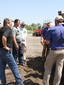 Team meeting at tractor training event