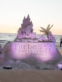 Customized sand castle at corporate welcome reception