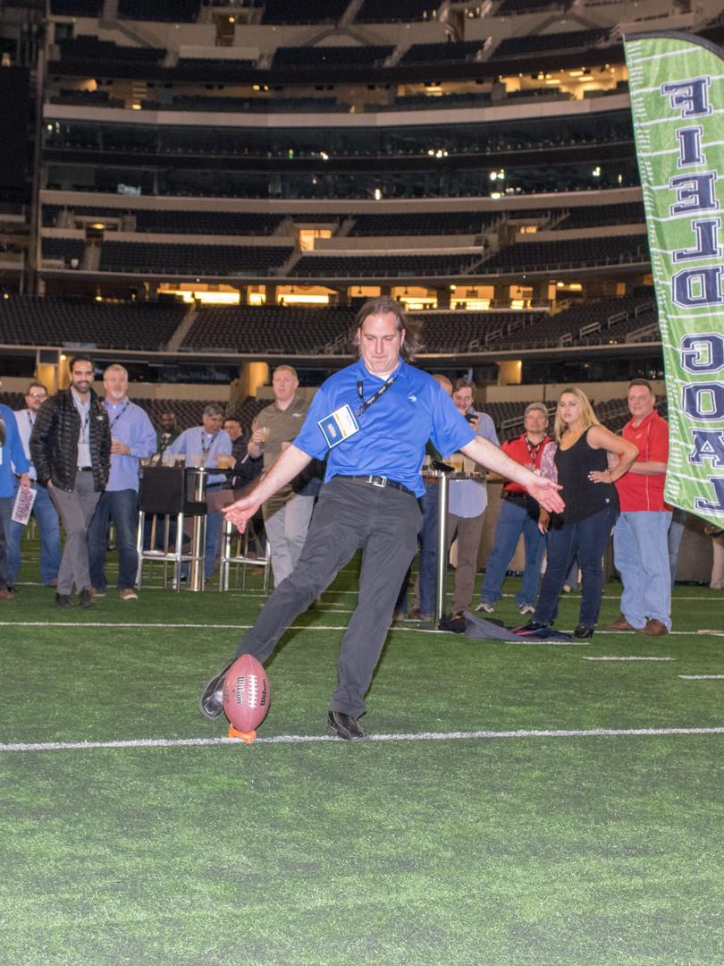 Man kicking field goal at VIP event