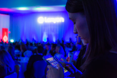Women looking at cellphone during general session event