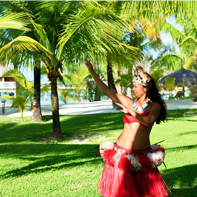Tahitian dancer greeting guests upon arrival of incentive trip