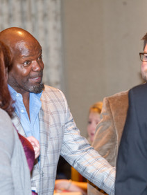 Emmitt Smith mingling with attendees after keynote speech