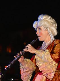 Costumed clarinet player for themed awards dinner