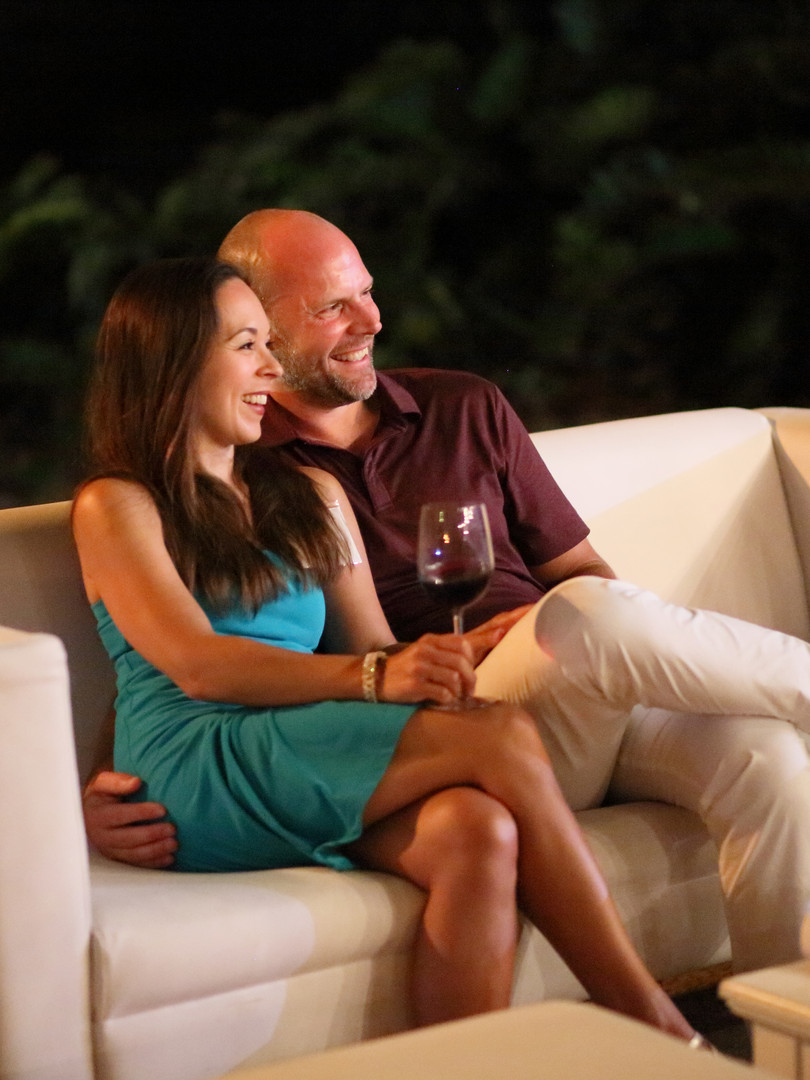 Couple sitting on couch on the beach