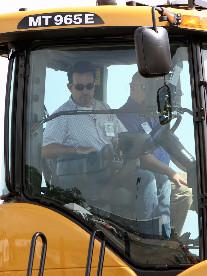 Attendees experience first hand tractor training