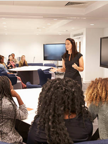 Female speaker presenting a breakout session
