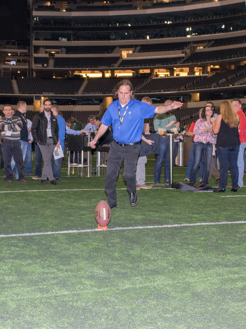 Man kicking field goal