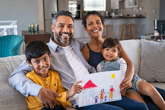 happy-ethnic-family-showing-painting-wit