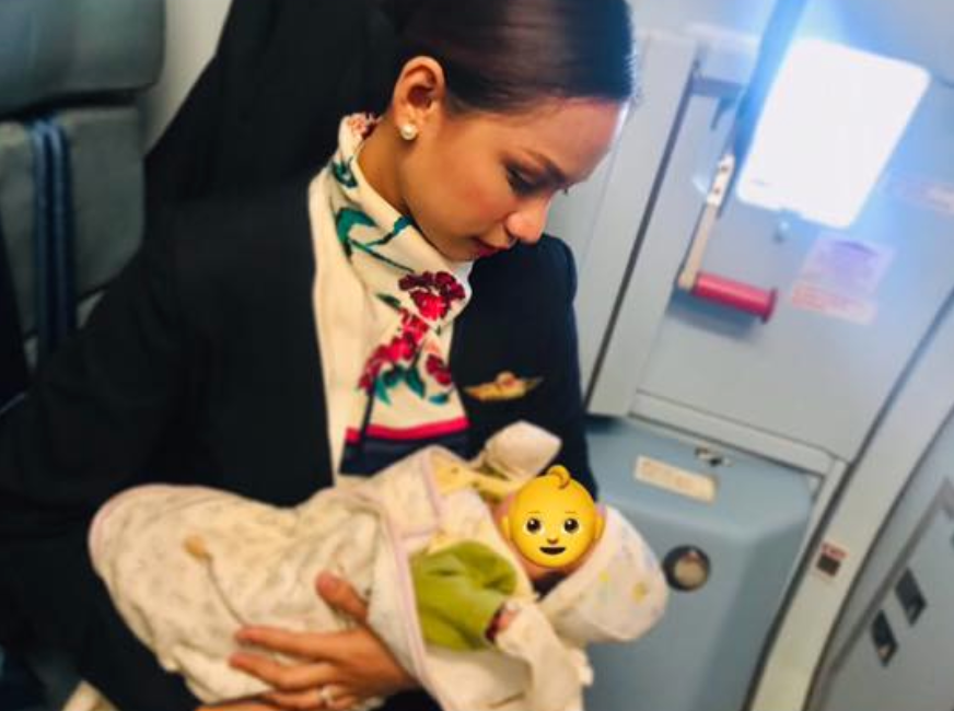 Philippine Airlines flight attendant breastfeed