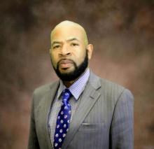 Professional Headshot of Pastor Scott Onqué, Faith in Place's new Policy Director