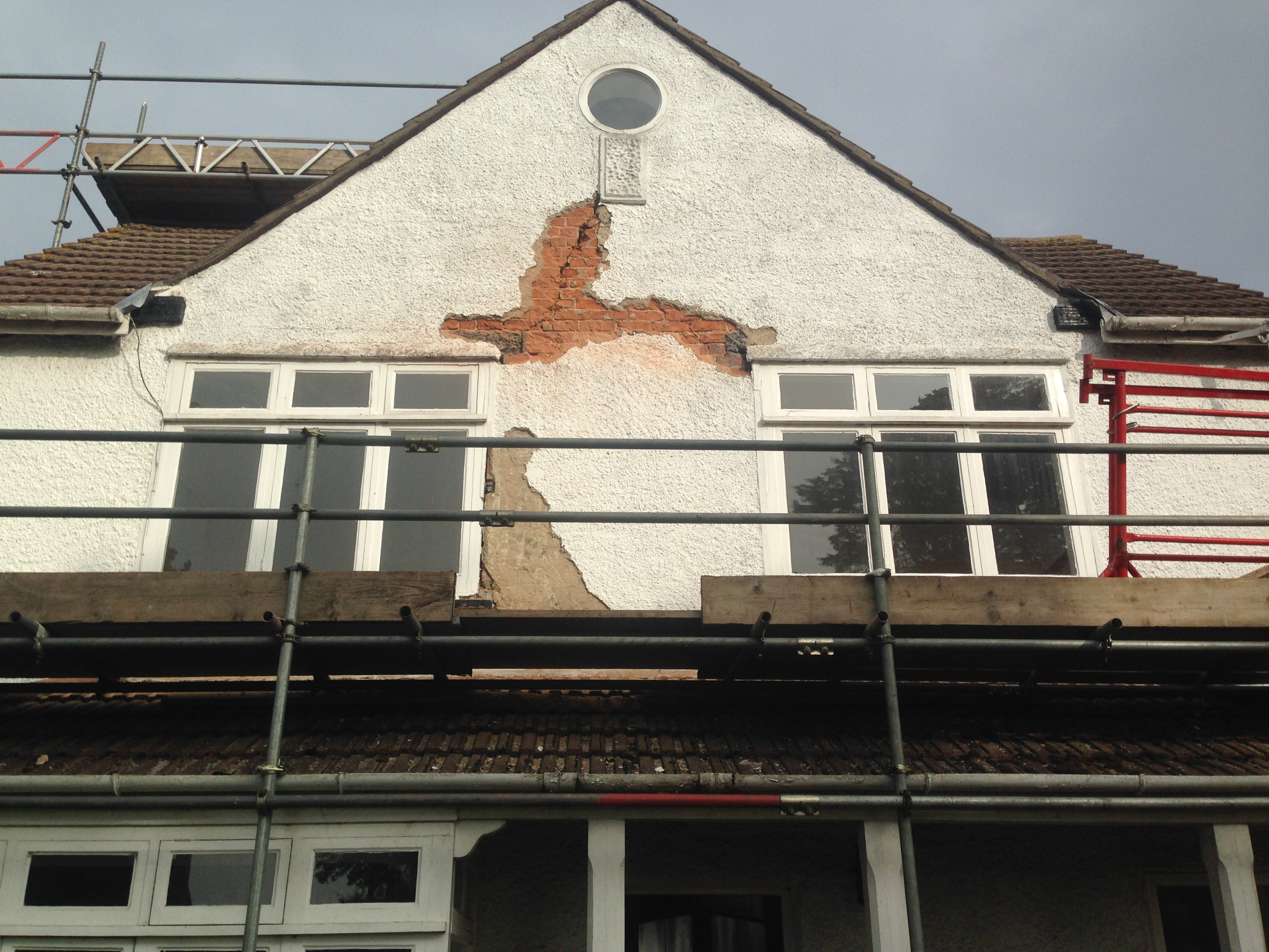 Repairing Blown Render House Front