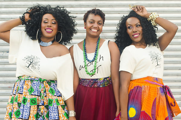 three women wearing Blessed Designs t-shirts