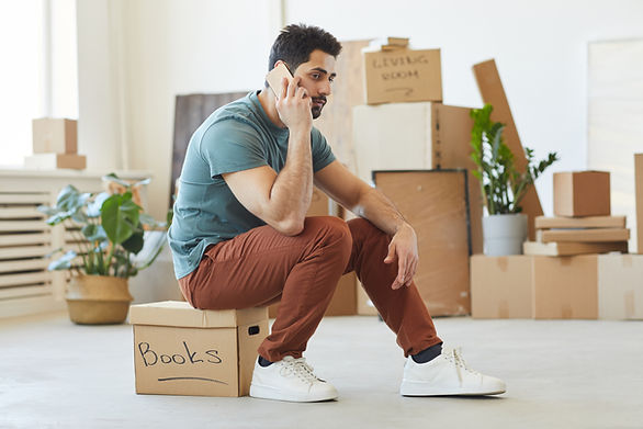 young-man-sitting-on-the-box-and-talking