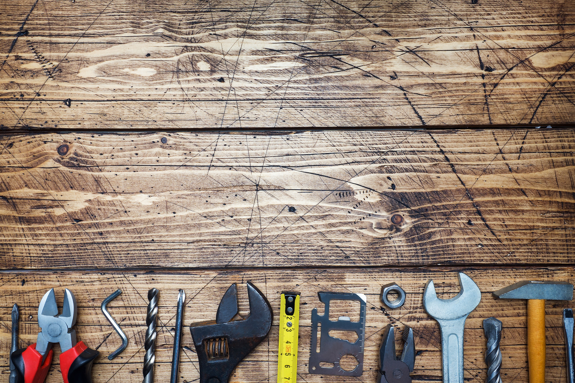 set-of-different-repair-tools-on-wooden-
